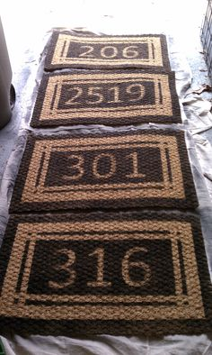 I made these as Christmas gifts for some family members last year and they were a big hit! DIY custom address doormats... Mats originally from IKEA... Numbers cut from thin cardboard (I used giftboxes), striping done with masking tape. Paint 2-3 thin and even coats with exterior-grade spraypaint. Remove tape and numbers and allow to dry overnight. -- Have to do this next year for our townhouse.