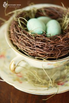 from Mustard Seed Interiors. Love the idea of a bird nest tucked into a tea cup.