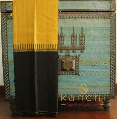 Yellow kanchipuram saree with wide black border. To place an order- FB: https://web.facebook.com/kanchi.signature.collection/ Whts app - 08089813556 Website - www.kanchisignaturecollection.in Email -kanchi.signature@gmail.com