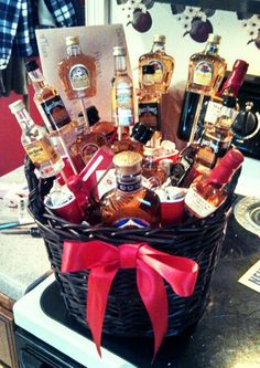 Whiskey Birthday Basket for my love ♥ Filled with - mini red solo shot glass cups, Jack, Makers, Crown, Tequila, chocolate kisses etc. Hot glued a red ribbon, used foam ball cut in half and wooden sticks hot glued to the back of the mini bottles. Gonna tie a balloon to the side & give it to my man. I know he will L O V E it (: Made it all for ~ $100. Perfect birthday/anniversary/valentines day gift for a man !