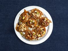 Christmas Morning | Traditionally made from strips of dough left over from making baklava, here these crunchy pastry spirals are formed from a simple pasta-like dough, soaked in a light lemon syrup, and topped with a shower of toasted chopped hazelnuts, pistachios, and pine nuts.