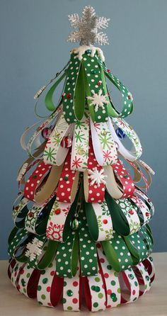 """Got together with Jessica yesterday, and Kathy and Ruth Ann were making these (wish I knew their Pinterest IDs!). Christmas Tree using Styrofoam Cone, Craft Paper & Embellishments. They were using ribbon and straight pins. Kathy cut the ribbon at 4"""" while Ruth Ann cut her ribbon at 5.25""""."""