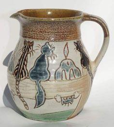 Майкл Мосс студия керамики соли, глазури кошки кувшин Superb кувшин с изображением 10 кошек, сидящих на заборе, глядя в сторону кувшина. Каждая кошка индивидуально рисованной и по-другому. Кувшин стоит 10 см в высоту и находится в отличном состоянии. Обратите внимание на подпись на основании рукоятки. На базе есть впечатление штамп керамики Llanbrynmair. Восхитительный чувство юмора керамика кувшин с этой хорошо известной производителя.