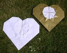 Our Giant Origami Hearts hanging out with a wee crop of daisies  Check out our store to see our other handmade paper decorations! Luxury handmade paper decor - paperstreetdolls.etsy.com