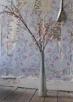 Peeling turquoise and purple wallpaper reveals hidden treasures