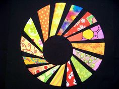 Great modern spin (no pun intended) on a dresden plate block--Attic Window Quilt Shop