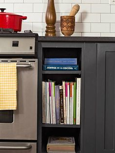 The niches flanking the cooking range in this kitchen are a handy spot for cookbooks and magazines