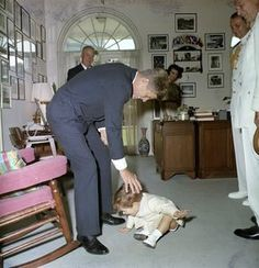 John F. Kennedy, Jr., with President Kennedy, Evelyn Lincoln, nurse Maud Shaw, Naval Aide to the President Captain Tazewell Shepard, and others in the President's Secretary's Office prior to Memorial Day Ceremonies - John F. Kennedy Presidential Library & Museum