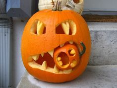 Hahaha!! This is so going to be my puking pumpkin this year, with the little pumpkin doing the puking!!