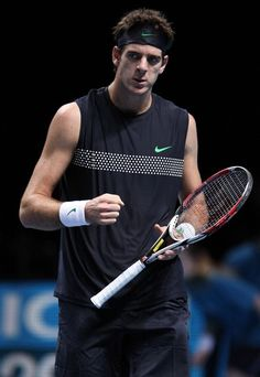 Juan Martin Del Potro Photos Photos - Andy Murray (GBR, red racquet) beats Juan Martin Del Potro (Argentina, head band) in the first round robin match, 6/3, 3/6, 6/2. Barclay's ATP World Tour Finals, formely known as the Masters of Tennis, gathering the top 8 players in the world for the last tournament of the year, held at the O2 Arena in London. It's the first time the Masters are played in London. - Andy Murray Plays Juan Martin Del Potro in the ATP World Tour Finals