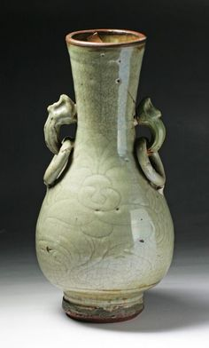 """A Rare Ming Dynasty Longquan Porcelain Vase of baluster form with cylindrical neck with elephant head shaped handles around shoulder pending two rings, applied overall with celadon glaze with attractive crackle network while falling brown on the rim; of Ming Dynasty; Size: H: 11"""""""