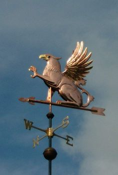 Griffin Weathervane by West Coast Weather Vanes.  The Griffin weather vane featured in the photo above was made in copper with optional gold leaf accents on its crest, beak, talons, claws and the edges of its wings. It also looks nice to optionally gild the arrow tip and fletching. The Griffin has large translucent glass eyes.