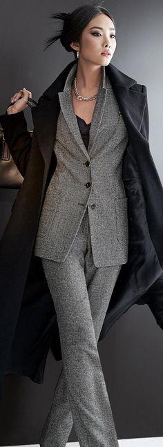 Beautiful, perfectly cut Gray suit, chic black coat.