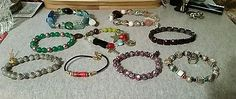 BRACELETS LOT OF 9 GLASS AND OTHER MULTI COLORED VARIOUS STYLES AND DESIGNS