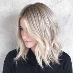 Soft butter blonde waves by Chrissy Rasmussen