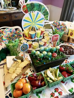 The Very Hungry Caterpillar Eric Carle birthday party ideas decorations food table cake pops DIY