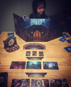 Mysterium, social deduction game using art cards and cooperative play