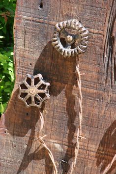 We're in the severe drought area ...so I do water 'some' but can't water everything ... so am lookin' for 'drought-resistant' gardening! Here's a couple new Barnwood Blooms I made the last week or so: Chose a beautiful old barnwood board, gave it a coat of Poly ... added some GJ spigot handles that ...