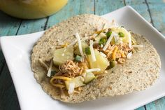 slow cooker pineapple salsa chicken recipe serves 8 slow cooker chicken and turkey recipe view in a tortia shell from the side