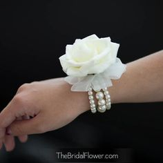 White Rose Corsage w/ Pearl Bracelet. (Mother of the Groom's Corsage) Rose Corsage, Corsage And Boutonniere, Corsages, Boutonnieres, White Corsage, White Boutonniere, Wedding Boutonniere, Rose Bouquet, Prom Flowers