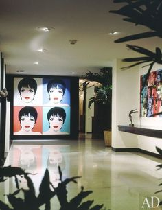 The sleek entrance hall in Liza Minnelli's Manhattan apartment holds two pieces by her friend Andy Warhol: a four-panel portrait painting of Minnelli and a montage of the performer and her mother, Judy Garland.