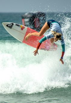 Bianca Buitendag getting air at the Vans US Open of Surfing in Huntington Beach, California