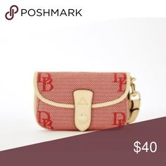 "Coming soon - Dooney & Bourke Signature Wristlet Signature Snap Flap Wristlet. Carry your basics in style with this attractive wristlet made in Dooney & Bourke signature fabric with leather trim. Snaps shut. Detachable wristband. Dimensions:  6.25"" L x 1.5"" W x 4"" H Dooney & Bourke Bags Clutches & Wristlets"