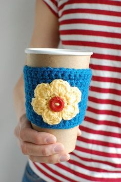 Blue coffee cozy with yellow flower and red button by The Cozy Project, via Etsy.
