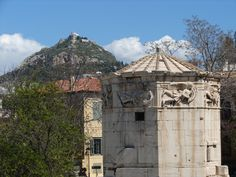 The Tower of the Winds,behind it Mount Lycabettus with the Agios Georgios chapel,Athens