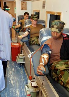 Service members donate blood to the Armed Services Blood Program.