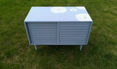 Thrifty Treasures: Vintage chic cabinet. Add interest to your furniture with fun stencils.