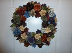 An autumn pine cone wreath to decorate your door and welcome your family and guests. Pine cones are secured to a wire base with wire and with hot glue. It is approximately 19-20 wide.  Please do not hesitate to contact me if you would like a custom made pine cone wreath, including size, colors and accessory descriptions.