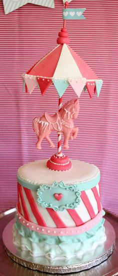 Loving this carousel birthday cake, perfect for a girl birthday party! See more party ideas at CatchMyParty.com. #birthdaycake #carousel #girlbirthday