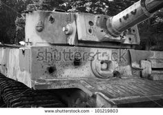 destroyed tank PzKpfw VI Tiger with holes from shells on sunny day in autumn