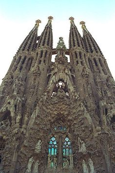 East facade of Sagrada Familia, Barcelona. Reminds me of when the waves come in and desecrate your gnarly sandcastle. Colour Architecture, Unique Architecture, Historical Architecture, Beautiful Places In The World, Oh The Places You'll Go, Places To Visit, Amazing Places, Spain And Portugal, Portugal Trip