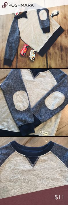 🚒 Baby Gap 4T Sweatshirt 🚒 🚓 Gently used Baby Gap sweatshirt-- size 4T-- navy blue and gray-- gray elbow patches-- one little snag (see last picture)-- body: 100% cotton; long sleeves: 60% cotton 40% polyester 🚑 GAP Shirts & Tops Sweatshirts & Hoodies