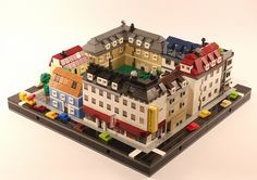 This was part of my Lego club's layout at our exhibition last weekend. We had tons of extravagant once-per-city buildings but almost no housing so I came up with some low-key apartment buildings. Construction Lego, Lego Moc, Lego Lego, Lego Craft, Lego Games, Lego Batman, Micro Lego, Lego Boards, Amazing Lego Creations