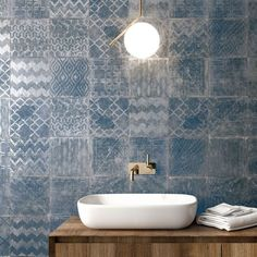Check out our new Cuadrado Glam Porcelain Tile range consisting of 3 on-trend colours, blue, grey and black.  The sleek Mediterranean and Metallic decorative patterns will enhance any living area.  These tiles can be used on both floors and walls giving you endless design options.   Order Your FREE Samples today. Tiled Hallway, Space Projects, Outdoor Tiles, Downstairs Bathroom, Blue Tones, Tile Patterns, Porcelain Tile, Kitchen Flooring, Color Trends
