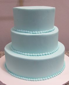 Elegant looking teal tiers and beading