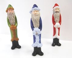 Santa Pencil Ornament.  One of our own-brand bisque pottery designs.  We used Duncan Fired Snow on the blue Santa.