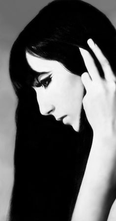 Cher by Richard Avedon for Vogue. The facial expression in this image appears to be sad, supported by the fact she is looking down at the floor. She is facing to the side, deliberately avoiding direct communication with the camera, and appears to be lost in her own thoughts.