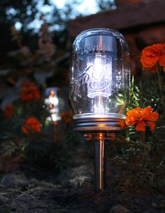 Love this! A $3.79 garden path solar light gets a vintage makeover when covered with a jelly jar. The transparent glass allows the sun to power the lamp to shine you and your guests along your way.