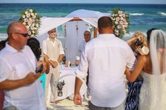 Groom is very happy to see his bride coming to the altar, pretty set-up at the Akiin Beach Club in Tulum. Mexico wedding photographers Del Sol Photography.