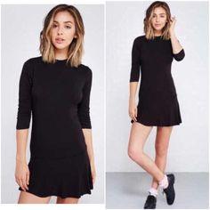 "NWT black mock neck drop waist dress Brand new. 3/4 sleeves, 32"" from shoulder to hem. Rayon/spandex Dresses Mini"