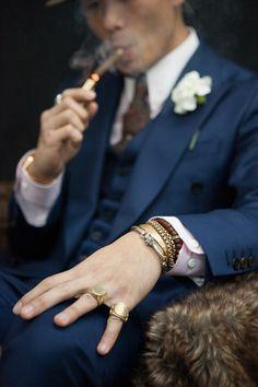 Smoking cigar with style.