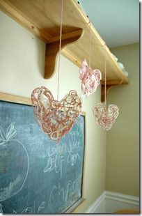 yarn shapes - these are large hanging shapes, but i could see this on a smaller scale to make a necklace