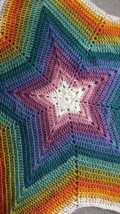 This wonderfully bright rainbow star blanket is perfect for a buggy,pram or car seat. Its unique shape makes it the ideal blanket to wrap around a baby whilst in a sling/carrier. If you can picture the top point being able to cover the head and the o. Crochet Star Blanket, Crochet Stars, Crochet Granny, Crochet Blankets, Afghan Patterns, Crochet Blanket Patterns, Star Patterns, Crochet Home, Crochet Baby