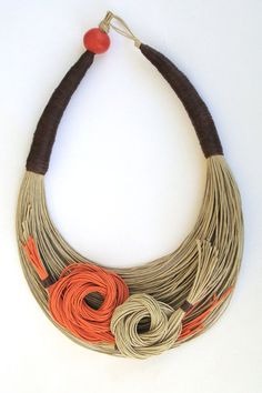 Necklace | Liza Gizi. All natural fiber with a wood painted bead for the clasp.--from etsy