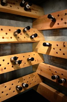Rustic wine cellar that stores bottles in monster slabs of cedar stacked up like Lincoln logs. GoodBye Playroom, Hello Yoga Studio with Adjoining Wine Cellar - episode 403 Anitra Mecadon DIYNetwork https://www.facebook.com/DIYMegaDens?ref=hl
