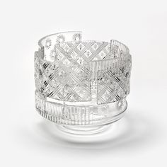 Nendocollaborated with master blowers Martin Janecky and Jiri Pacinek to createthe vases by reheating a variety of glass objects decorated with traditional cut glass patterns, slicing them open and then rearranging the pieces. As a manner of making, the process was like sewing together animal hides, or piecing togethersmall fragments of cloth to create a great patchwork quilt, say the designers. (via Patchwork Glass Vases by Nendo) #glass #vases